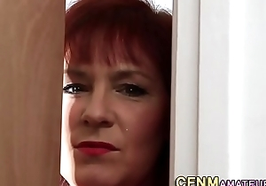 Clothed milf jerks cock