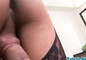 Tattooed shemale beauty pulling her big cock
