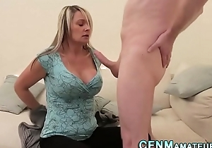 Busty clothed milf jerks
