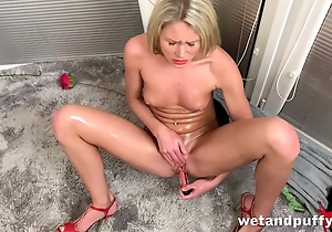 Slim festival actively masturbates with red sex toy