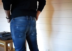Trying on grasping jeans