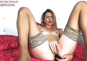 Hot peaches MILF pounding her ass with a black dildo - anal toy sex wearing tan nylon stockings